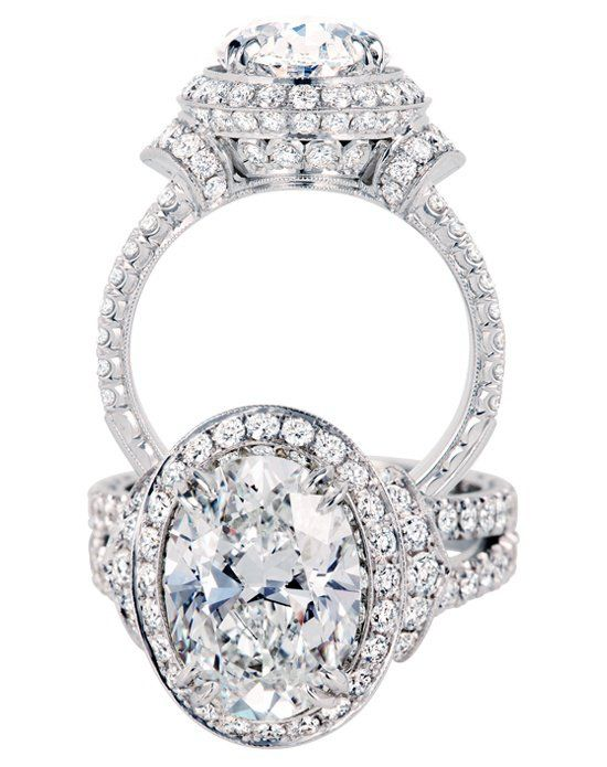 Engagement Rings Oval stone engagement ring with pave round stones