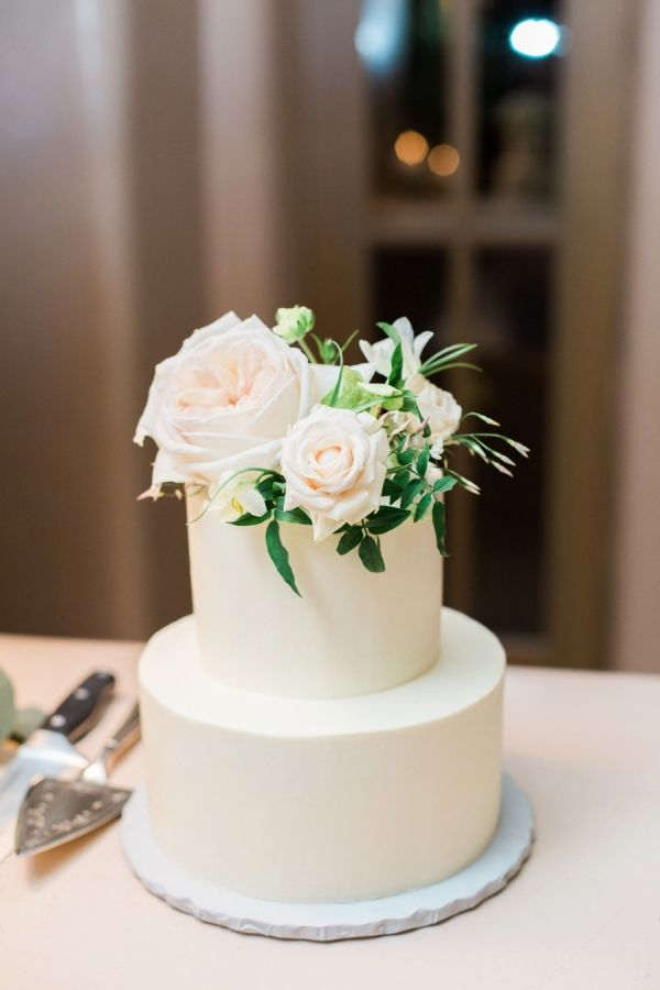 wedding cakes simple two tier wedding cake topped with flowers and greenery www stylemepretty - simple beach wedding decorations
